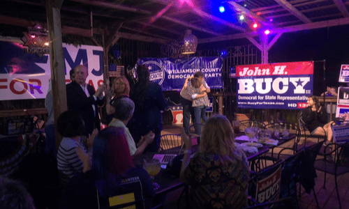 Election Watch Party event photo, Kim Gilby hugging John Bucy upon his win